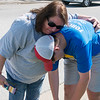 Brenda Bard gives her exausted grandson Cail Tingle, 16, a hug at the end of the Webb City leg of the 2018 Law Enforcement Torch Run on Tuesday.<br /> Globe | Roger Nomer