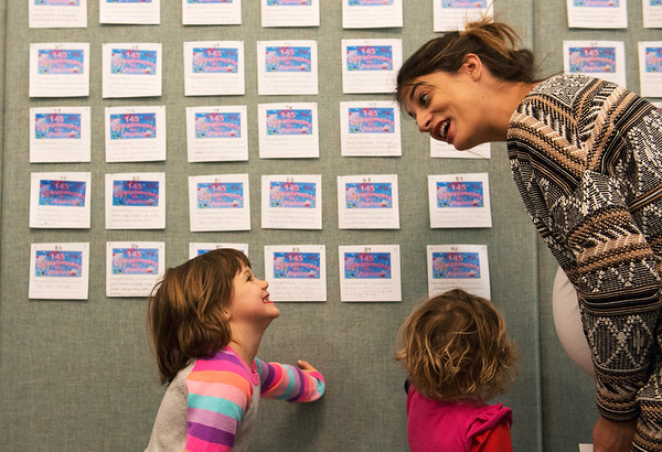 Rachel Grindle discusses with Lillie, 5, and Aliyah, 3, which compliments to vote for during Friday's 145th birthday celebration at Joplin City Hall.<br /> Globe   Roger Nomer
