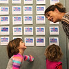 Rachel Grindle discusses with Lillie, 5, and Aliyah, 3, which compliments to vote for during Friday's 145th birthday celebration at Joplin City Hall.<br /> Globe | Roger Nomer