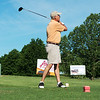 Steve Meeds, Joplin, tees off for the Roper Kia team during Friday's Joplin Bright Futures Golf Tournament at Schifferdecker Golf Course.<br /> Globe | Roger Nomer