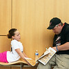Lillian Borchardt, a fifth grader at Lockwood Elementary, talks with her father Don during a break Monday at the 2018 Joplin Globe Spelling Bee at Thomas Jefferson Independent Day School.<br /> Globe   Roger Nomer