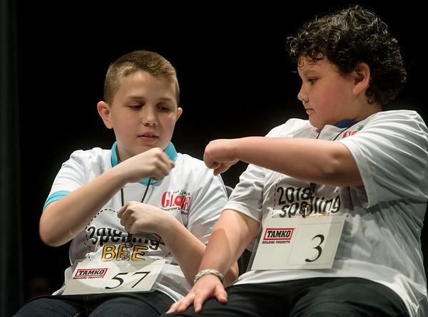 Zachery Webb, a fifth grader from Seneca Intermediate, left, and Berkeley Ulrey, a fifth grader from the Association of Christian Homeschooling, congratulate each other with a fist bump for making the final two during Monday's 2018 Joplin Globe Spelling Bee at Thomas Jefferson Independent Day School.<br /> Globe | Roger Nomer
