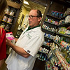 Tim Mitchell, pharmacist and owner, talks to a customer at Mitchell's Downtown Drug Store on Friday in Neosho.<br /> Globe | Roger Nomer