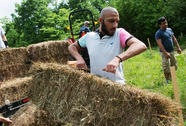 Ahmed Lnaim, a Pittsburg State junior from Saudi Arabia, helps set up the baja track on Wednesday at PSU.<br /> Globe   Roger Nomer