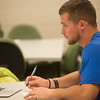 Carson Day, a Missouri Southern junior from Marietta, Ga., takes notes during a human resources management class on Tuesday at MSSU.<br /> Globe | Roger Nomer