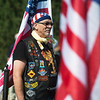Robert Bachert holds a flag during a Memorial Day ceremony at Mount Hope Cemetery on Monday.<br /> Globe | Roger Nomer