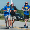 (from left) Cail Tingle, 16, his father Brandon and Teague Braker, Webb City Police communications specialist and Special Olympics organizer, run during the 2018 Law Enforcement Torch Run on Tuesday.<br /> Globe | Roger Nomer