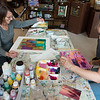 Sylvia Trout, left, and Lynn Lewman, both from Neosho, paint during Wednesday's Experimental and Abstract Art class at the Local Color art gallery.<br /> Globe | Roger Nomer