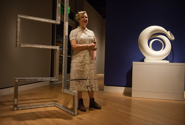"""Molly Larkey talks about her sculpture, left, being shown next to a Georgia O'Keeffe sculpture in """"The Beyond: Georgia O'Keeffe & Contemporary Art"""" at Crystal Bridges Museum of American Art on Thursday.<br /> Globe   Roger Nomer"""