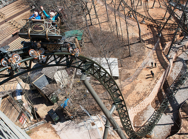Members of the Herschend family take the first plunge on the Time Traveler roller coaster at Silver Dollar City on Tuesday morning.<br /> Globe | Roger Nomer