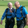 Dale Oglesby greets his father Jim after they land from their skydive on May 19 at the Ozark Skydive Center.<br /> Globe | Roger Nomer