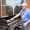 Brad Walker, Freeman Director of Cardiac Clinical Services, grills during Friday's free luncheon to honor area emergency medical services workers at Freeman West. In addition to the luncheon, dinner was be available to EMS personnel who work overnight. Meats and drinks were provided by Freeman, Schumacher Clinical Partners and Midwest AeroCare. Freeman employees provided side dishes and desserts.<br /> Contributed Photo