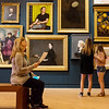 Debra Wright, Memphis, looks over the artworks on display in the redesigned Early American Art Galleries at the Crystal Bridges Museum of American Art on Thursday.<br /> Globe | Roger Nomer