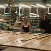 Workers sort boards at Heritage Oak on Tuesday afternoon.<br /> Globe | Roger Nomer