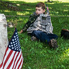 Wearing a military outfit complete with a Vietnam-era helmet, John Marshall Channel, 6, Webb City, listens to a presentation on WWI veterans at Carterville Cemetery on Monday.<br /> Globe | Roger Nomer