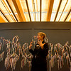 "Mindy Besaw, curator at Crystal Bridge Museum of American Art, talks about ""We the People"" by Nari Ward during a tour of the new Early American Art Galleries at the museum on Thursday.<br /> Globe 