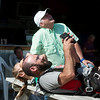 Neil Oglesby, grandson of Jim, left, and Lance Nichols, family friend, watch as Jim Oglesby jumps out of a plane on May 19 at the Ozark Skydive Center.<br /> Globe | Roger Nomer