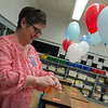 Lisa Sweet, first grade teacher at Mark Twain Elementary, prepares balloons for her class on Monday.<br /> Globe | Roger Nomer