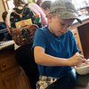 August Jones, 7, Garden City, Mo., makes peanut milk at the Carver National Monument on Friday.<br /> Globe | Roger Nomer