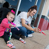 Krystia Hartin plays bubbles with her daughter Kiah, 2, on Friday outside the Joplin Mong Sudon Tai Karate Studio.<br /> Globe | Roger Nomer