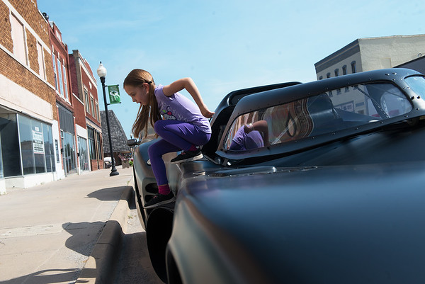 Anna Aldridge, 6, exits a replica Batmobile in downtown Baxter Springs on Wednesday.<br /> Globe | Roger Nomer