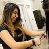 Glendry Lopez cuts a customer's hair on Friday at The Hive Salon in Carthage.<br /> Globe | Roger Nomer