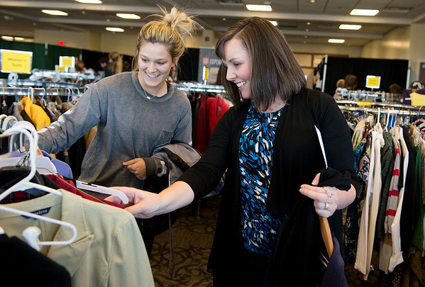 Sherry Noller helps Dru Clark, a Missouri Southern senior from Collinsville, Okla., find business clothing at the annual Dress to Impress event at Missouri Southern on Thursday. The event, sponsored by MSSU Career Services and the Young Professional Network, gave MSSU students a chance to find outifts for job interviews.<br /> Globe | Roger Nomer