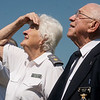 Delmar Hampton, Civil Air Patrol chaplain, and his wife Jean, also a Civil Air Patrol member, watch a flyover of T-6 Texans on Monday at Mount Hope Cemetery.<br /> Globe | Roger Nomer