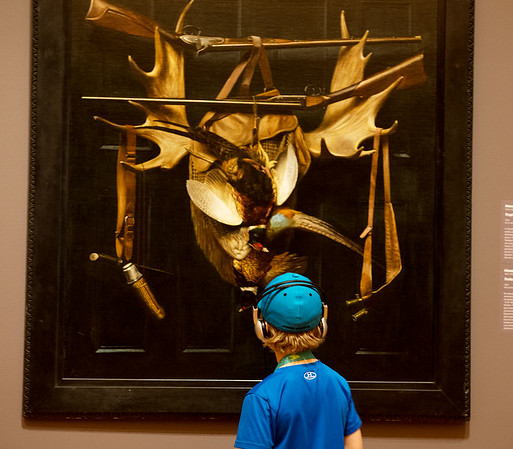 Banks Brown, 6, Dallas, uses an audio guide at Crystal Bridges on Thursday. With the redesign of the Early American Art Galleries, the museum will update their audio tours of the artworks.<br /> Globe   Roger Nomer