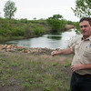 David Jenkins, mined land wildlife area manager, talks about some areas that will be open to the public.<br /> Globe | Roger Nomer