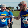 Cail Tingle, 16, and Teague Braker, a Webb City Police commications supervisor and Special Olympics organizer, get ready for their leg of the 2018 Law Enforcement Torch Run on Tuesday.<br /> Globe | Roger Nomer