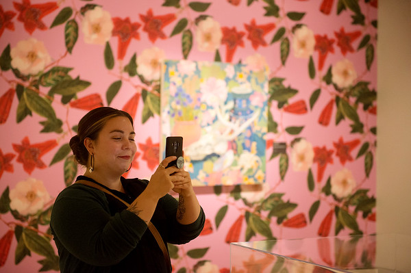 "Anna Valdez proudly Instagrams her work in ""The Beyond: Georgia O'Keeffe & Contemporary Art"" at Crystal Bridges Museum of American Art on Thursday.<br /> Globe 