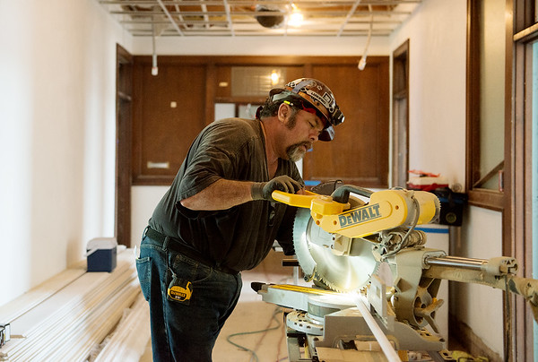 John Inahara, with Vecino Group, works on the Block 22 apartments on Tuesday in Pittsburg.<br /> Globe | Roger Nomer