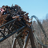 Riders come out of a corkscrew turn on the Time Traveler roller coaster at Silver Dollar City on Tuesday.