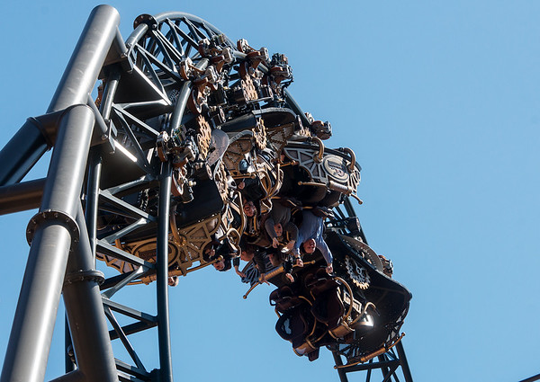 Riders flip upside down on the Time Traveler roller coaster at Silver Dollar City on Tuesday.<br /> Globe | Roger Nomer