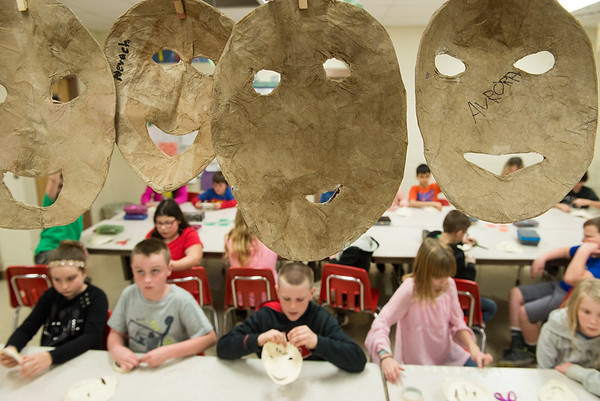 Granby fourth graders make paper masks for a mural on Wednesday afternoon in Granby.<br /> Globe | Roger Nomer