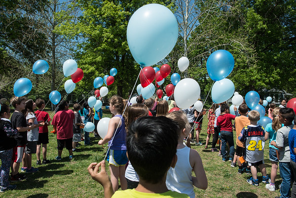 Students at Mark Twain Elementary prepare to launch balloons on Monday morning.<br /> Globe | Roger Nomer