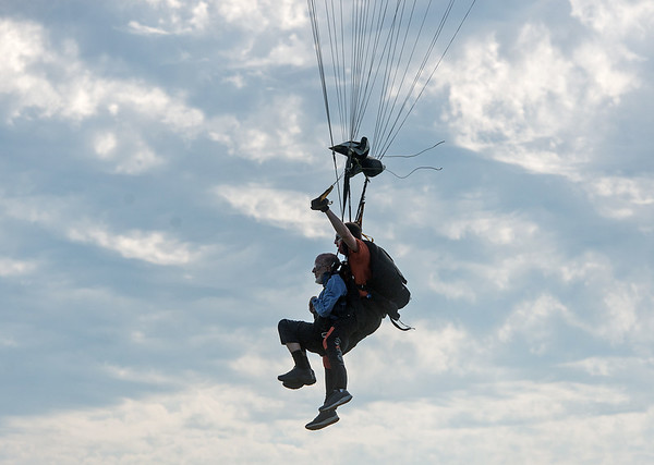 Jim Oglesby and his tandem partner Brad Barnett parachute into a landing area on May 19.<br /> Globe   Roger Nomer