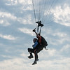 Jim Oglesby and his tandem partner Brad Barnett parachute into a landing area on May 19.<br /> Globe | Roger Nomer