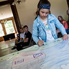 Rose Shepherd, 10, signs her winning poster from the 2018 Joplin Fair Housing Month Poster Contest on Monday at the Zelleken House.<br /> Globe | Roger Nomer