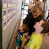 Nancy Keller and her grandsons Camden, 3, and Julian, 6, Lett look over compliments during Friday's 145th birthday celebration at Joplin City Hall.<br /> Globe | Roger Nomer