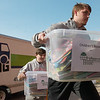 Sam, Carl Junction High freshman, left, and Seth, Carl Junction junior, Haynes help unload a donation of children's books at Lafayette House on Thursday.<br /> Globe | Roger Nomer