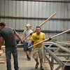 Workers sort boards at Heritage Oak on Tuesday afternoon.<br /> Globe   Roger Nomer