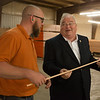 Zac Shepherd, president of Heritage Oak, gives Rep. Billy Long a tour of the Heritage Oak factory on Tuesday.<br /> Globe | Roger Nomer