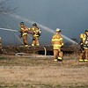 Joplin firefighters pour water on a fire near Junge and Byers on Thursday morning.<br /> Globe | Roger Nomer