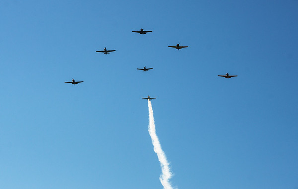 A group of T-6 Texans fly over Mount Hope Cemetery on Monday morning.<br /> Globe | Roger Nomer