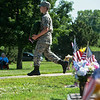 Civil Air Patrol Cadet Airman Dustin Frazier carries a wreath to be placed at the Veterans Memorial on Monday at Mount Hope Cemetery.<br /> Globe | Roger Nomer
