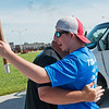 Cail Tingle, 16, gets a hug from his father Brandon before the 2018 Law Enforcement Torch Run on Tuesday.<br /> Globe | Roger Nomer