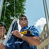 Navy veterans David Martin, left, and Steve Davis wait for their cue to raise the Navy flag at the Columbus Veterans Memorial on May 18.<br /> Globe | Roger Nomer
