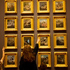 "Visitors look at Martin Johnson Heade's series ""The Gems of Brazil"" on display at Crystal Bridges on Thursday.<br /> Globe 